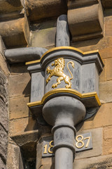 Edinburgh, Scotland, UK - June 14, 2012: Closeup of golden Royal Scottish Lion emblem on hopper water collection box on top of downpipe from gutter at Castle.