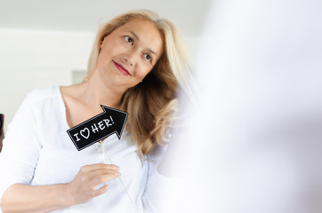 Woman standing with photo both