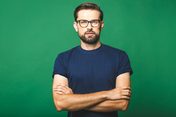 A portrait of young handsome man in casual isolated on green background with glasses. Fototapete