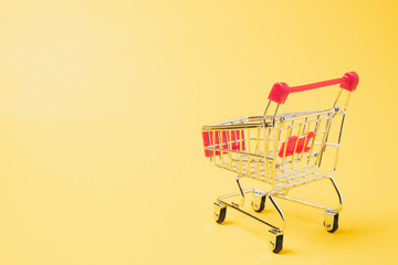A Shopping Cart or Shopping trolley on yellow background