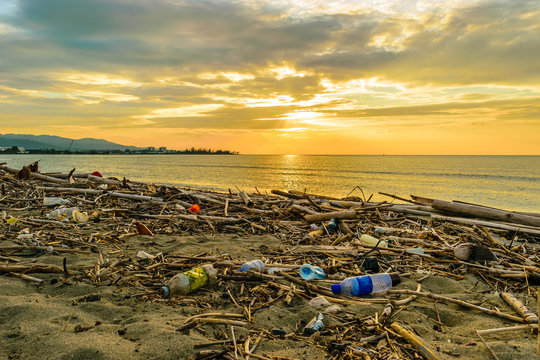 Plastics garbage on beach. Reduce Reuse Recycle. Environmental marine pollution. Waste rubbish from ocean washed ashore on land in scenic location/setting. Ban on single use plastic.