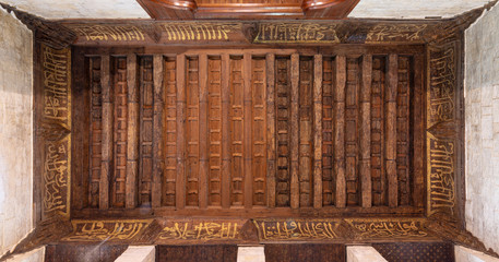 Wooden ornate ceiling with floral pattern decorations at Sultan al Ghuri Mausoleum, Cairo, Egypt