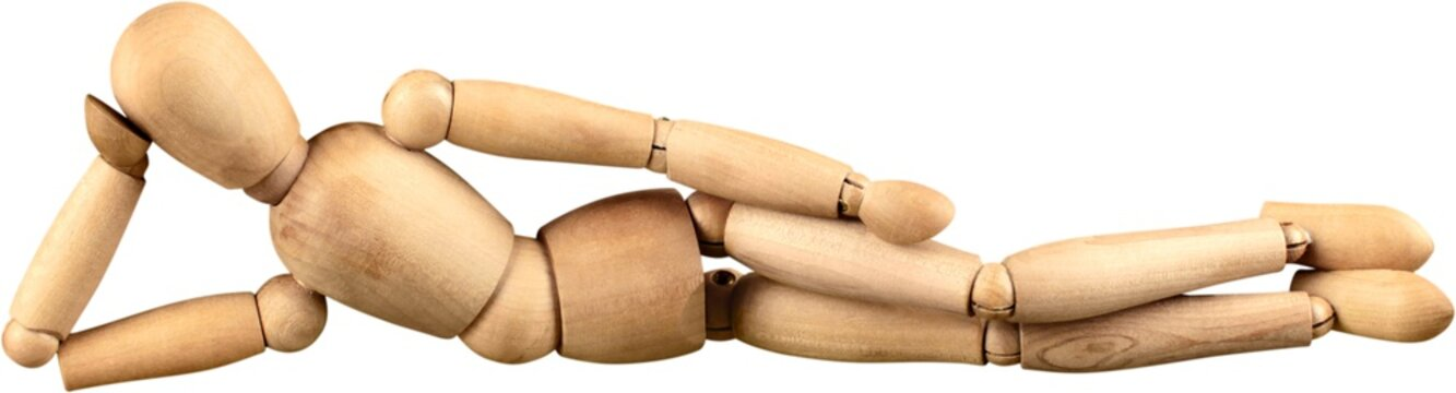 Miniature wooden mannequin in a laying down pose
