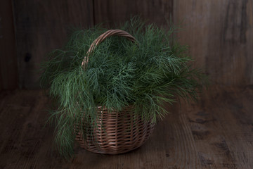 Fresh dill in a basket on a table