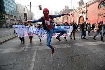 A demonstrator wearing a Spider-Man costume attends a teachers' march during a national strike demanding better working conditions in Santiago