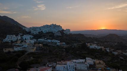 Aerial view of a Mediterranean village at sunset