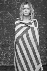 Black and white photo beautiful woman standing in a blanket. Wake up in the morning when it's cool. Fashion style.