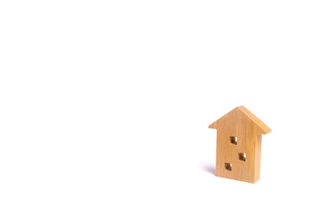 Wooden figure of a multi-storey house on a white background. Three-story house. Buying and selling of real estate, construction. Apartments and apartments. Minimalism. for presentations.