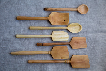 Wooden spoons on cloth
