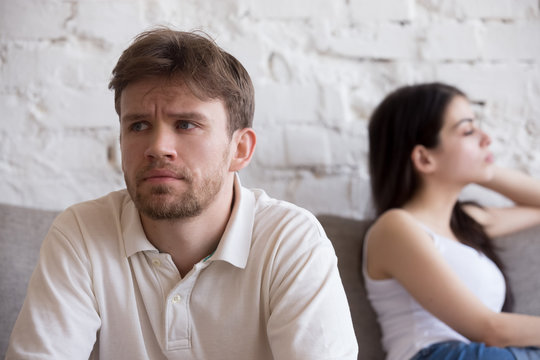 Upset millennial man think about relationship problems, having fight with proud female lover, offended couple not talking after family quarrel, sad male consider breaking up or divorce with girlfriend