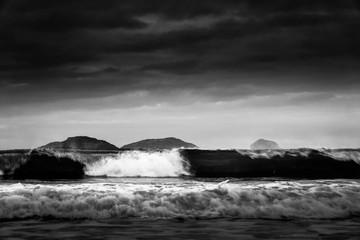 crashing waves with dark skies