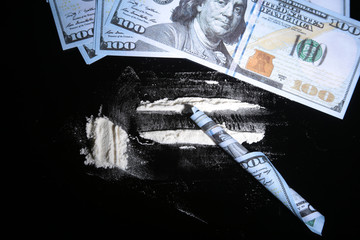 Cocaine drugs heap still life on a mirror with rolled 100 dollar banknote, closeup view.