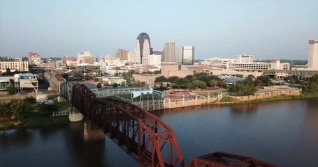 Fotomurales - The Red River Flows Slow Between Bridges in Shreveport Louisiana