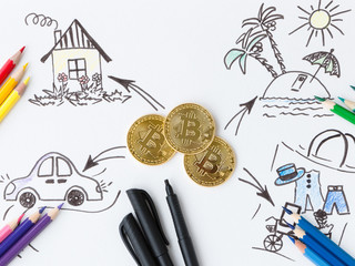 Coins of popular crypto currency bitcoin. Concept. Bitcoins can pay for the purchase of real estate, car, vacation and many other purchases.