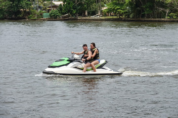 Printed roller blinds Water Motor sports Happy young couple enjoying and having fun riding on a jet ski. Tropical coast of Sri Lanka
