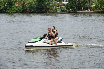 Recess Fitting Water Motor sports Happy young couple with thumbs up enjoying and having fun riding on a jet ski. Tropical coast of Sri Lanka
