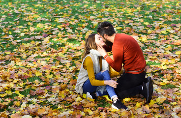 Man and woman with romantic faces on autumn trees background