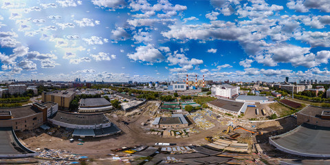Crushing old buildings for constructing new. Aerial 360-degree view from drone.