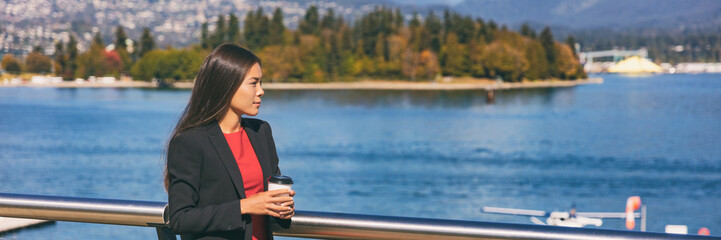 Asian business woman pensive drinking coffee at lunch break banner. Businesswoman relaxing outside at nature landscape panoramic crop. Wall mural