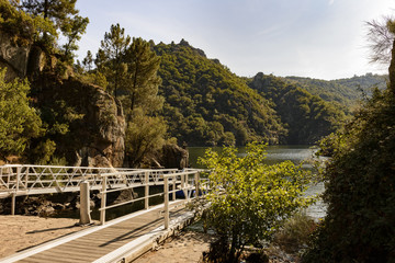 Sil Canyon, Sober (Lugo), Spain. August 25, 2018: View of Chancis pier at river Sil canyon and Ribeira Sacra valley in Galicia. The area is famous for its scenery and terraced vineyards.