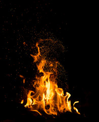 Flame of fire with sparks on a black background