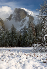 Half Dome rises from the surrounding winter wonderland that is Yosemite National Park.