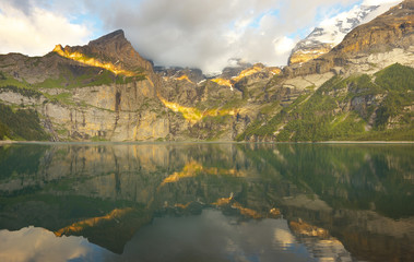 Mountain landscape with a lake of Oeschinensee during a sunset, Switzerland