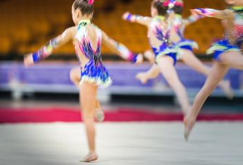 Poster de jardin Gymnastique Rhythmic gymnastics competition - blurred