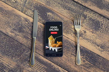 Mobile phone with order food online word on screen. Online food marketing concept. Blogging concept.