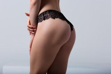 Woman wearing black lace panties