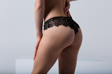 Woman wearing black lace panties