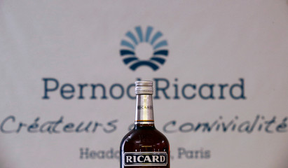 A logo is seen on a bottle of the Ricard aniseed-flavoured beverage displayed during French drinks maker Pernod Ricard news conference to announce the company annual results in Paris