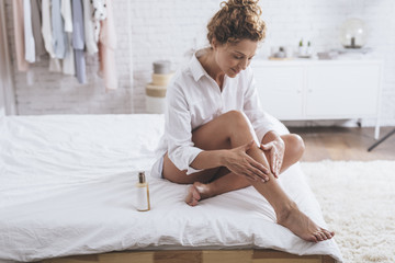 Woman Using Cosmetic Lotion