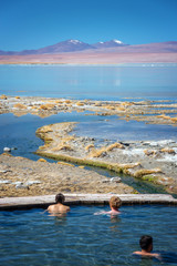 Tourists enjoying a bath in the hot springs of Laguna Polques, Sud Lipez province, Potosi, Bolivia