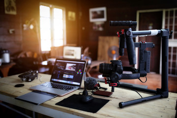 Vlogger equipment for Filming a movie or a video blog Drone Steadicam Camera Stabilizer and laptop. Wall mural