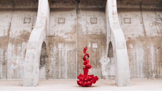 Woman dressed in red dancing flamenco in Malaga