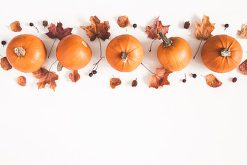 Autumn composition. Pumpkins, dried leaves on white background. Autumn, fall, halloween concept. Flat lay, top view, copy space