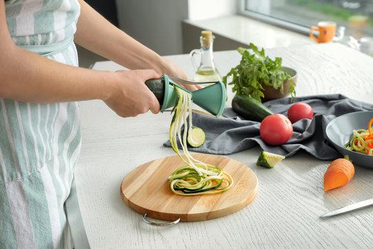 Woman making zucchini spaghetti
