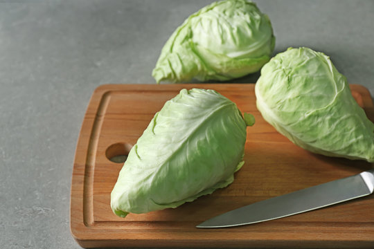 Fresh pointed cabbage on wooden board