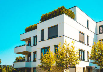 Obraz beautiful apartment building with green tree - fototapety do salonu