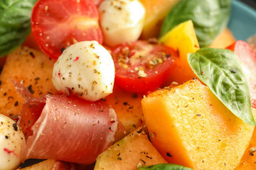 Delicious melon with prosciutto and mozzarella cheese, closeup