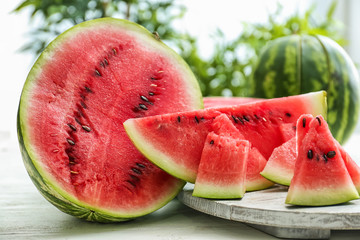 Sliced ripe watermelon on white table