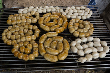 Ring sausage being grilled at the outdoor market