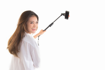 Back view of women to make a selfie stick portrait  look at camera on white background.