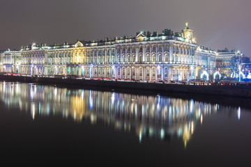 Hermitage (Winter Palace) and Neva river at night during New Year and Christmas holidays, Saint Petersburg, Russia