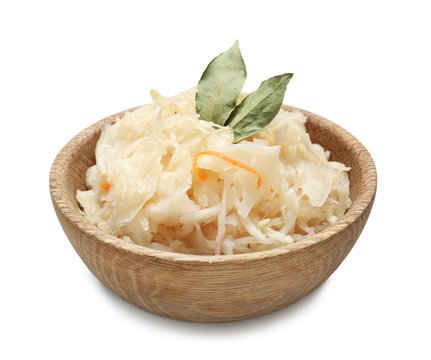 Bowl with delicious sauerkraut on white background