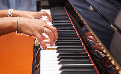 man is playing the piano