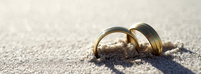 Wedding rings at the beach Banner design