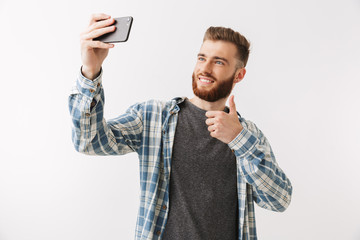 Portrait of a cheerful young bearded man