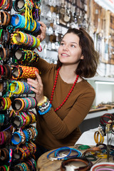 Woman offering to buy fashionable bracelets